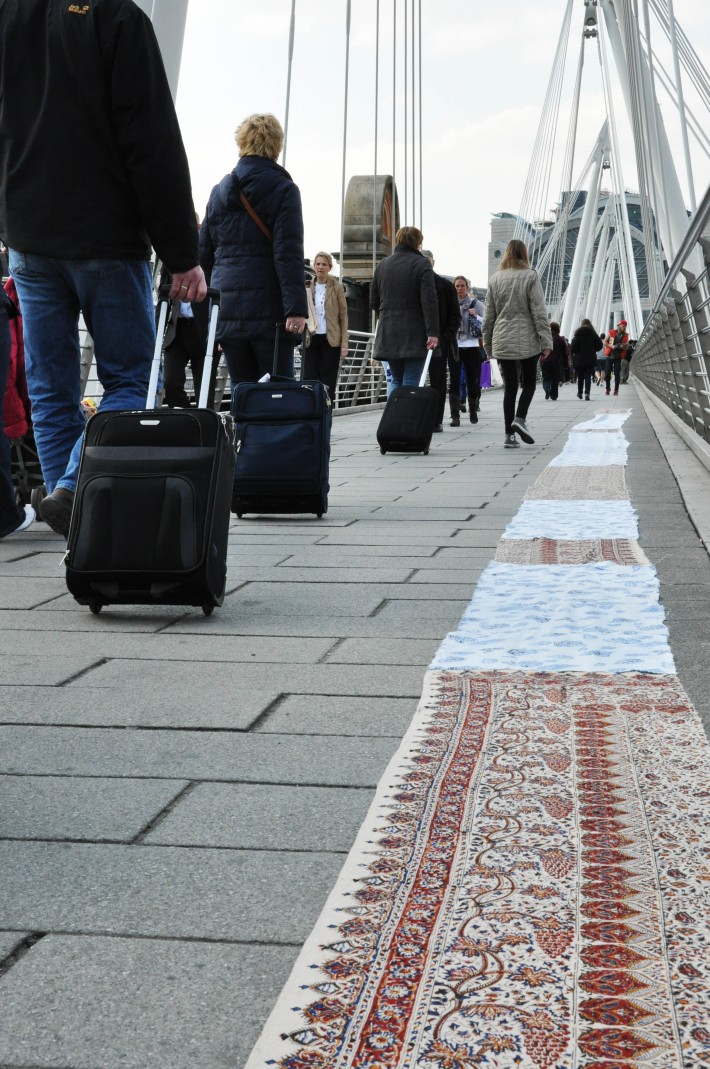 Fabric spread along Hungerfordbridge by the Southbank Centre
